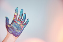 A Colorfully Painted Hand On A Ackground