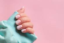 Gradient Manicure And Hands Spa. Beautiful Woman Hand Closeup. Manicured Nails And Soft Hands Skin. Beautiful Woman's Nails With Beautiful Baby Boomer Manicure, Pink Background. Copy Space