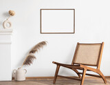 Fototapeta Kawa jest smaczna - Classical style interior with artwork template on a white wall. Modern home design concept. Blank picture frame mock-up in interior design. Living room with armchair