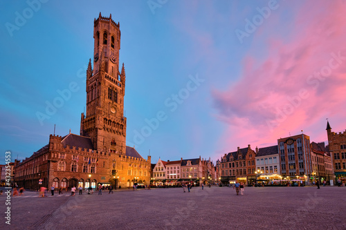 Belfry tower and Grote markt square in Bruges, Belgium on dusk in twilight Fototapete