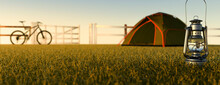 Camping At Sunrise In A Small Tent On A Grass Meadow With A Mountain Bike Next To The Tent 3d Render