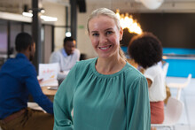 Portrait Of Caucasian Woman Smiling While Standing At Modern Office
