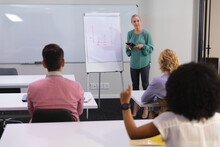 Caucasian Woman Giving A Presentation To Her Office Colleagues In Meeting Room At Office