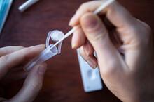Close Up Of A Person Using Coronavirus Covid-19 Rapid Antigen Home Testing Kit