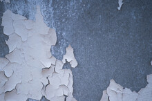A Gray Concrete Wall With Remnants Of Beautifully Cracked White Paint With A Gradient Of Light And Space For Text. Background