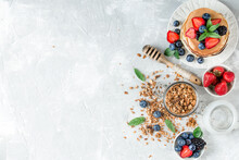 Healthy Breakfast With American Pancake, Granola, Fruits, Berries On White Background.