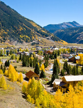 Silverton Colorado In Autumn With Golden Aspen Trees And Spruce Trees Dotted On The Mountain Slopes And Across This Small Mountain Town In San Juan County