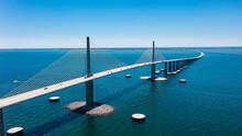 Sunshine Skyway Bridge In Tampa Bay Florida. Large Suspension Bridge That Ships Pass Underneath. Florida Gulf Coast Fishing Pier.