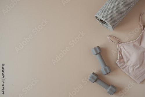 Fotografie, Obraz Aesthetic creative flat lay of yoga, fitness, workout training equipment on neutral beige background