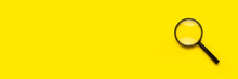 Magnifying Glass Loupe Search Symbol On Yellow Background With Copy Space. Banner