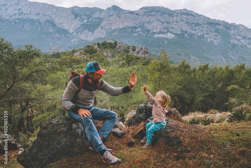 Family father and child daughter high five hands traveling in mountains hiking together summer vacation adventure lifestyle outdoor Lycian way in Turkey - fototapety na wymiar