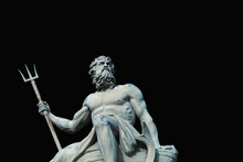The Mighty God Of Sea And Oceans Neptune (Poseidon) The Ancient Statue Against Black Background.