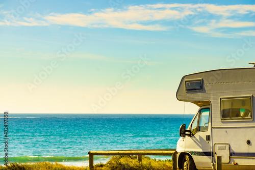 Foto Camper rv camping on sea shore, Spain