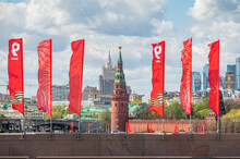 The Bolshoy Moskvoretsky Bridge Is Decorated With Red Flags In Honor Of Victory Day On May 9. View Of The Kremlin Towers And The Foreign Ministry Building.