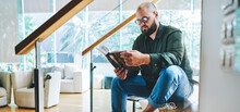 Calm Man With Book In Modern Apartment