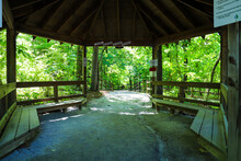 A Large Brown Wooden Pergola With Benches At The Entrance Of The Park With A Dirt Footpath And A Brown Wooden Fence Along The Path At Newman Wetlands Center In Hampton Georgia