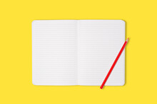 School Or Office Notebook With Red Pencil Isolaed On Yellow Background. Top View. Mock Up.