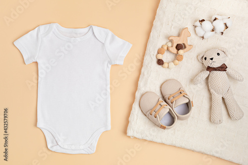 Mockup of white infant bodysuit made of organic cotton with eco friendly baby accessories.  Onesie template for brand, logo, advertising. Flat lay, top view - fototapety na wymiar