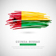 Brush flag of Guinea-Bissau country. Happy independence day of Guinea-Bissau with grungy flag background