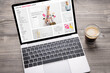 Leinwandbild Motiv Laptop with website of online fashion store on screen