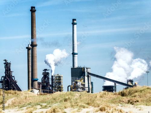 Fotografia, Obraz Steel factory with big chimneys in IJmuiden, the Netherlands