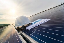 White Safety Helmet And Check Chart On The Solar Cell Board.Natural Energy.Solar Panel Photovoltaic Installation,alternative Electricity Source - Sustainable Resources Image Concept
