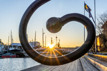 Sunset Through Special Handle Of Fence On Island In Center Of Stockholm