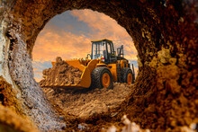Wheel Loader Are Digging The Soil In The Tunnel Construction Site On The Sky Background