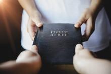 Woman Hands Giving Bible