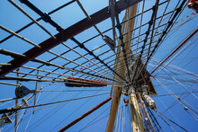 Mast And Ropes Of Classic Sailboat, View Of The Ship's Masts From Below, Detailed Rigging Without Sails