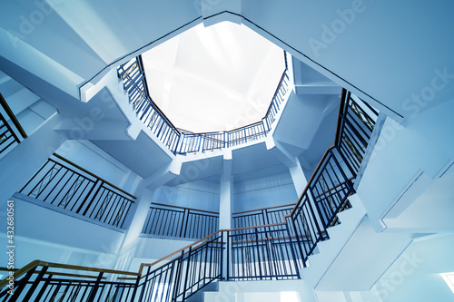 Upside view of a spiral staircase Fotobehang