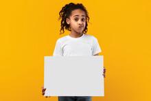 Black Girl Holding Blank White Advertising Billboard At Studio