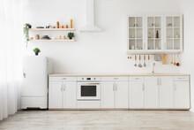 Minimal Light Scandinavian Kitchen Interior. White Furniture With Utensils, Shelves With Crockery, Small Refrigerator
