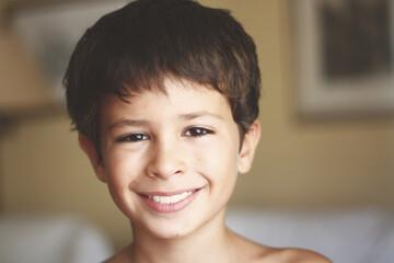 Closeup shot of a smiling cute Hispanic child