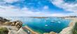 Leinwandbild Motiv Plage ensoleillée et bateaux de plaisance sur la côte de granit rose en Bretagne