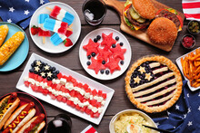 Fourth Of July, Patriotic, American Themed Food. Overhead View Table Scene On A Dark Wood Background.