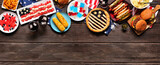 Fototapeta Kawa jest smaczna - Fourth of July, patriotic, American themed food. Overhead view top border on a dark wood banner background. Copy space.