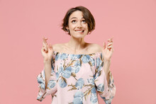 Young Caucasian Woman With Short Hairdo In Blouse Waiting For Special Moment Keep Fingers Crossed, Making Wish, Eyes Closed Isolated On Pastel Pink Background Studio Portrait People Lifestyle Concept