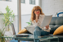 Business Woman Working With Documents And Laptop