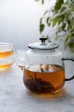 Chinese Flower Tea Brewed In A Transparent Teapot With Two Cups .