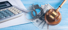 Financial Fraud Concept, Judge Gavel, Calculators And Handcuffs On Financial Documents