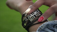 Bracelet With The Inscription Black Lives Matter On The Hand Of A Black Woman