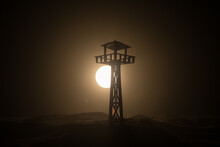 Creative Artwork Decoration. Silhouette Of Army Watchtower At Night. Selective Focus