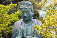 Close Up On The Bronze Statue Of Buddha Shaka Nyorai Praying With Two Hands Doing The Gesture Mudra Called Anjali In The Tendai Buddhism Tennoji Temple In Yanaka Cemetery