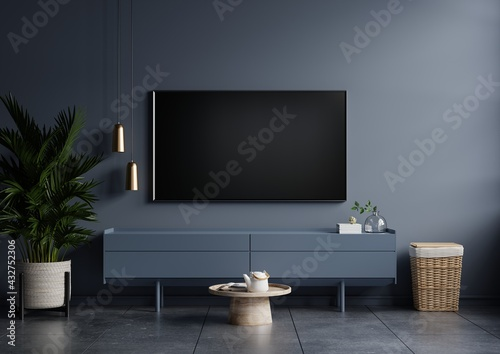 Obraz na plátně Modern interior of living room with tv on the cabinet on dark blue wall background