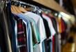 Leinwandbild Motiv Assortment of summer and autumn clothing in modern garment store interior