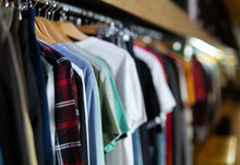 Assortment Of Summer And Autumn Clothing In Modern Garment Store Interior