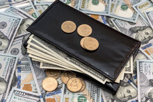 Leather Wallet With Us Dollar And Cent  On White Wooden Desk