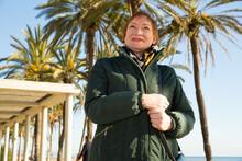 Closeup Portrait Of Stylish Mature Woman Strolling Along City Embankment In Warm Autumn Day