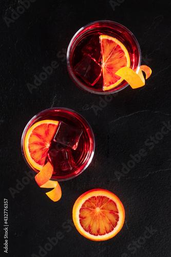 Obraz Orange cocktails with a slice of a blood orange, top shot - fototapety do salonu